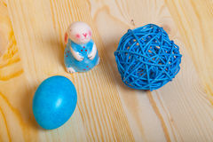 Easter symbols - colored eggs and bunny on light background Royalty Free Stock Images