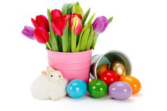 Easter symbols - painted eggs, tulips and toy rabbit Stock Images