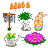 Easter symbols, plants in vases and flower bed Royalty Free Stock Image