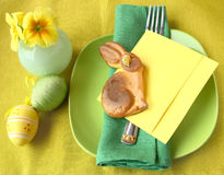 Easter table. Holiday decoration of the Easter table with a thin captain by a young hare and card for a guest Stock Images