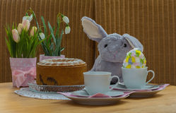 Easter table. Flowers and easter bunny on the coffee table Stock Images
