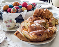 Easter table arrangement with bread, eggs and hot drink Stock Photos
