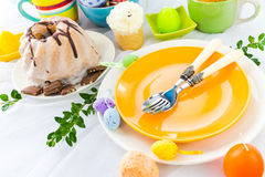 Easter table arrangement eggs sweets Stock Images