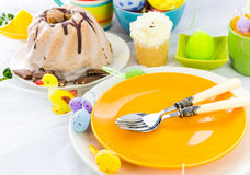 Easter table arrangement eggs sweets Stock Photos