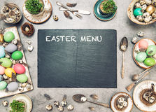 Easter table decoration colored eggs recipe menu Royalty Free Stock Images