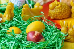 Easter table decoration with eggs and animals Stock Photo
