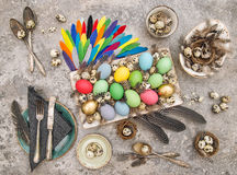 Easter table decoration eggs feathers vintage cutlery flat lay Stock Photography