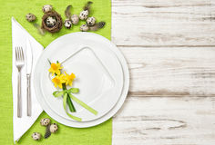 Easter table decoration eggs and narcissus flowers Stock Photo