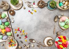 Easter table decoration eggs sweets copy space Flat lay Royalty Free Stock Image