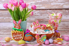 Easter table decoration with gingerbread cookies Stock Photo