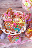 Easter table decoration with gingerbread cookies Stock Photography