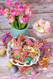 Easter table decoration with gingerbread cookies Royalty Free Stock Image