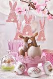 Easter table decoration with kissing rabbits figurine Royalty Free Stock Photos