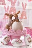 Easter table decoration with kissing rabbits figurine Royalty Free Stock Photography