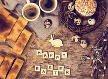 Easter table. Easter table decoration, pies, eggs, Easter cake, rabbit, seals, spring bouquet. Easter still life. The inscription 'Happy Easter stock photography