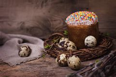 Easter table. Easter table decoration, pies, eggs, Easter cake, rabbit, seals, spring bouquet. Easter still life. The inscription \'Happy Easter royalty free stock photography