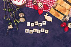 Easter table. Easter table decoration, pies, eggs, Easter cake, rabbit, seals, spring bouquet royalty free stock image
