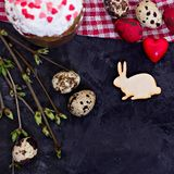 Easter table. Easter table decoration, pies, eggs, Easter cake, rabbit, seals, spring bouquet royalty free stock images