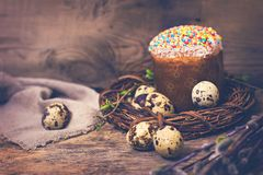 Easter table. Easter table decoration, pies, eggs, Easter cake, rabbit, seals, spring bouquet. Easter still life. The inscription \'Happy Easter stock photo