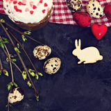 Easter table. Easter table decoration, pies, eggs, Easter cake, rabbit, seals, spring bouquet royalty free stock photo