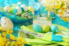 Easter table decoration in pistachio and turquoise colors. Easter table decoration with greeting card on the plate in pistachio and turquoise colors stock photos