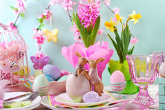 Easter table decoration with rabbits and spring flowers Royalty Free Stock Photo