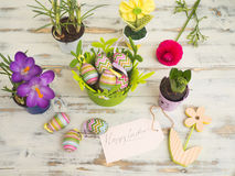 Easter table decoration on a wooden background from the top stock image