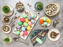 Easter table decorations colored eggs Flat lay Royalty Free Stock Images