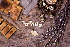 Easter table. Easter table decoration, pies, eggs, Easter cake, rabbit, seals, spring bouquet royalty free stock photos