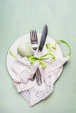 Easter  table place setting with cutlery and egg decoration on light green background Royalty Free Stock Photography