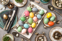 Easter table place setting decoration colored eggs Stock Photo