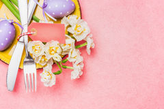 Easter table place setting on pink background, top view. Place for text Stock Photo