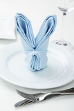 Easter table setting. Table setting with the Easter bunny napkin Stock Images