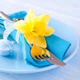 Easter table setting. With daffodil and cutlery Royalty Free Stock Photo