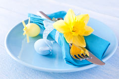 Easter table setting. With daffodil and cutlery Stock Images