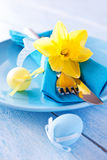 Easter table setting. Table setting with daffodil and easter eggs Royalty Free Stock Images