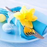 Easter table setting. With daffodil and cutlery Royalty Free Stock Image
