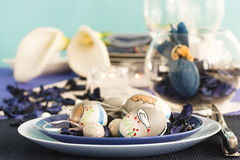 Easter table setting in blue and white stock photography