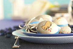 Easter table setting in blue and white stock images