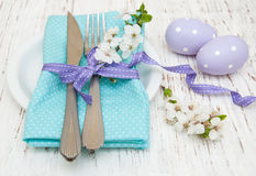 Easter table setting. With cherry blossoms  on a old wooden background Royalty Free Stock Photography