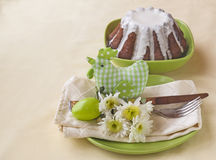 Easter table setting with chicken and flowers Stock Image