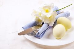 Easter laying table appointments, table setting options. Silverware, tableware items with festive decoration. Fork, knife and flow. Easter table setting Stock Images
