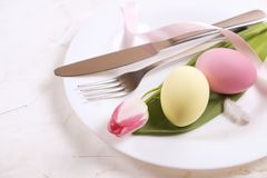 Easter laying table appointments, table setting options. Silverware, tableware items with festive decoration. Fork, knife and flow. Easter table setting Stock Image