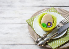 Easter table setting with cookie in shape of egg Royalty Free Stock Photo