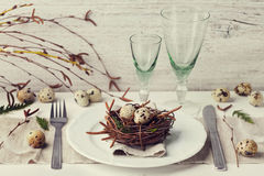 Easter table setting with eggs and spring decoration on rustic background Royalty Free Stock Photo