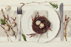 Easter table setting with eggs and spring decoration on rustic background, vintage toning. Top view royalty free stock images