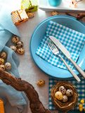 Easter table setting. Cutlery on plate. Spring table setting stock photos