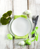 Easter table setting with grass bunny decoration. Top view Stock Images