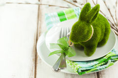 Easter table setting with green bunny decoration Royalty Free Stock Image