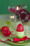 Easter table setting in green and red royalty free stock images